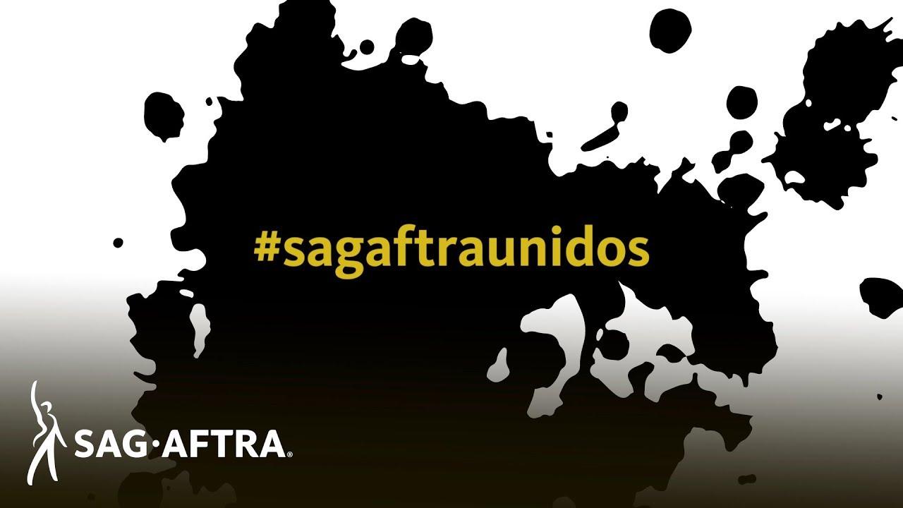 #sagaftraunidos en amarillo sobre fondo negro salpicado