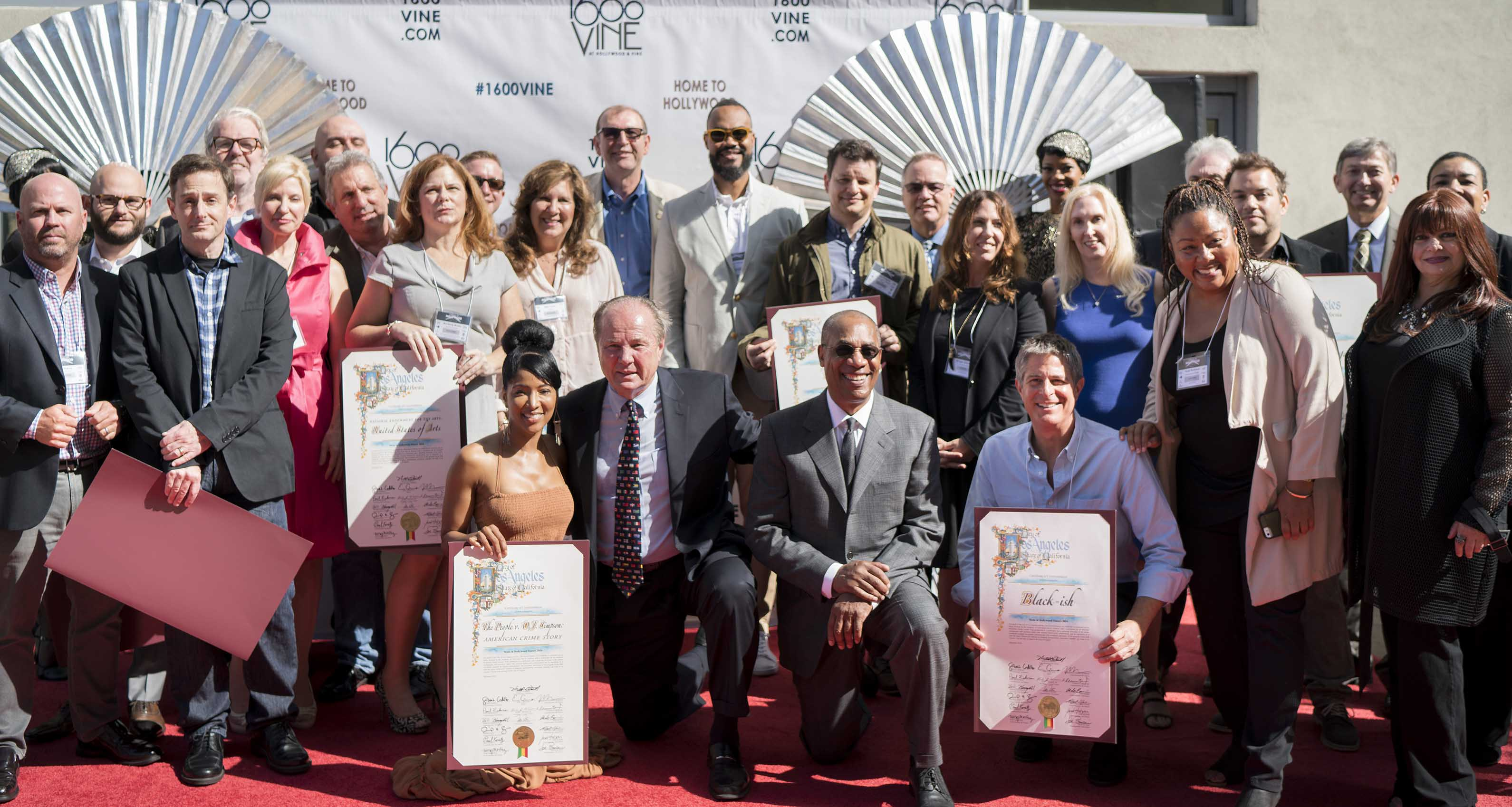 Former Los Angeles City Councilman Tom LaBonge and host Joe Morton joined by 2016 honorees. Photo by Riley Jamison.