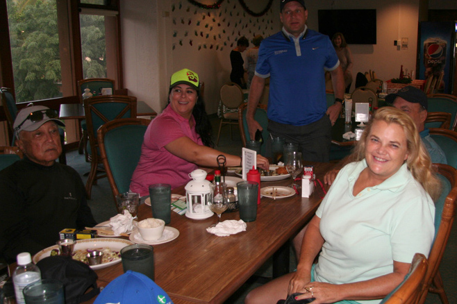 Jenny Tallent and members enjoy themselves at the 19th Hole.
