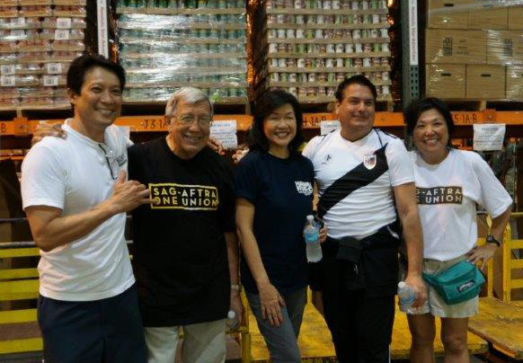 From left, members Greg Suenaga, Don Pomes, Julie Mercer, Anthoy Daniel and Leanne Teves volunteered at the annual National Letter Carriers Stamp Out Hunger food drive.
