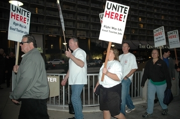 Firefighters joined a march with hotel workers outside the Hyatt Regency Century Plaza, where employees are seeking a new contract.