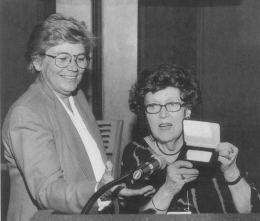 Outgoing AFTRA National President Shelby Scott, left, presented the George Heller Memorial Gold Card to Martha Greenhouse at the AFTRA convention in St. Paul, Minn. in August 2001.