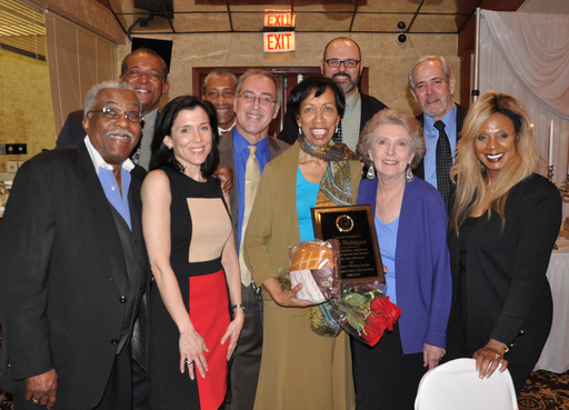 Fellow members and staff join Alma Washington to celebrate.