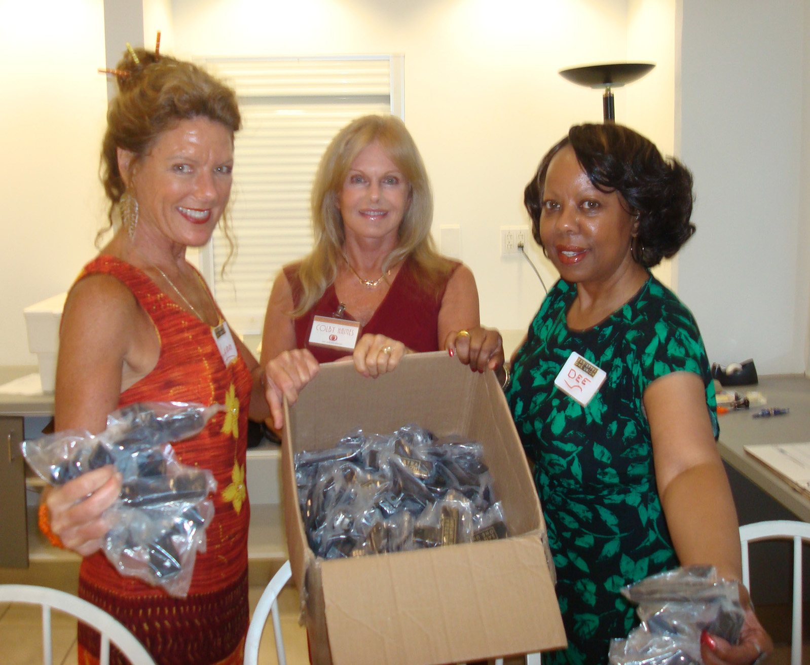Lynn Mcree, Colby Haines and Dee Rogers help set up SAG-AFTRA August mixer