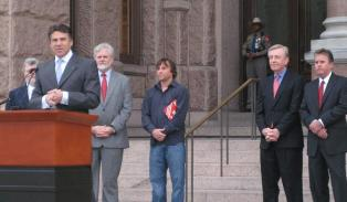 Governor Perry stands with film incentive supporters Don Stokes, Bob Hudgins, Robert Rodriquez, Sen. Bob Deuell and Garry Brown.