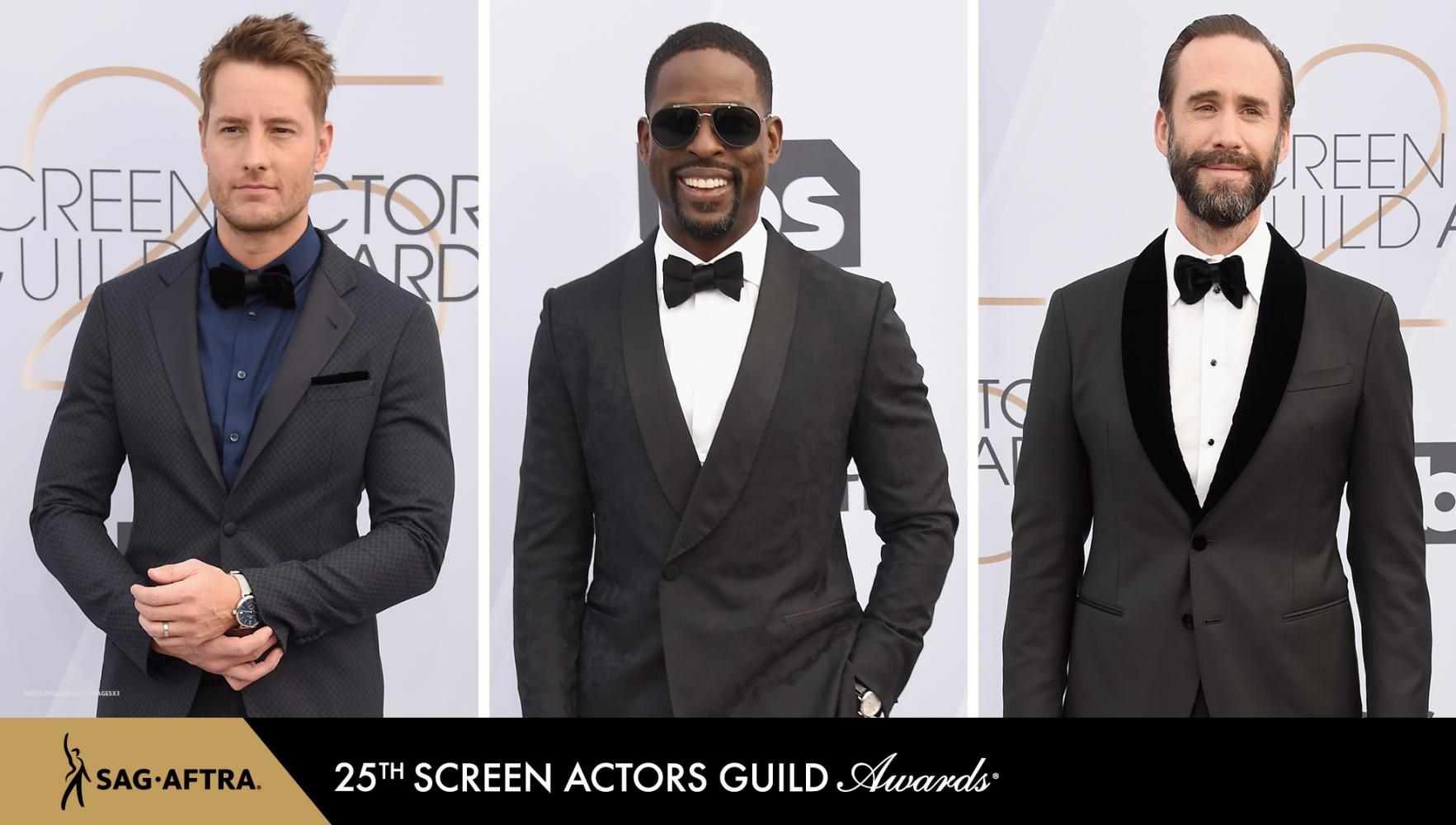 All standing in a dark tux with the SAG Awards backdrop