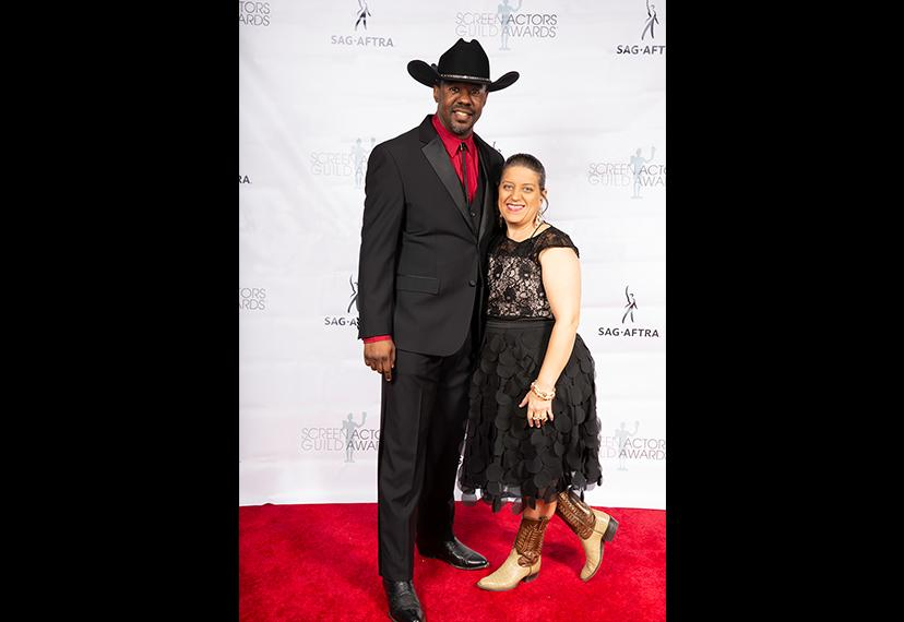 """Local Board member Avery White, left, and his wife Elizabeth know how to kept things """"Texas chic"""" on the red carpet. Photo by SuperCybers"""