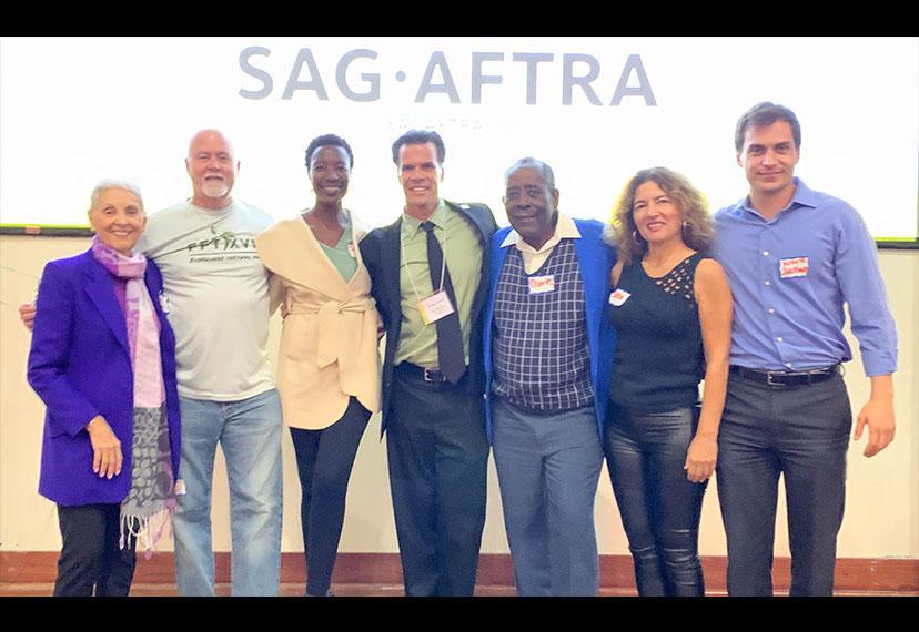 From left, members Sara Rogers, Michael Dean Walker, Sipiwe Anderson, Miami Local President John McKarthy, Charles Bonamy, Tasha Wenger and Mark Jackman.