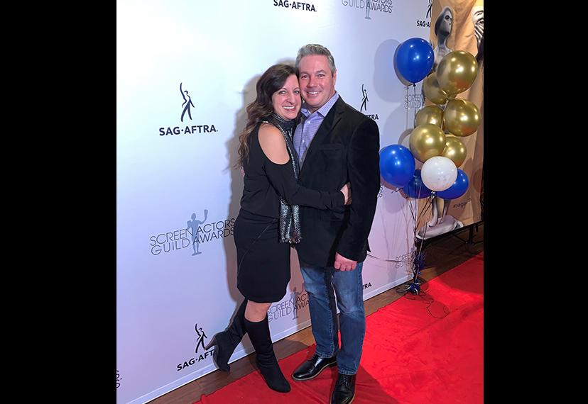 Member Guy Cooper and guest Lori Gangi smile on the red carpet. Photo courtesy Guy Cooper
