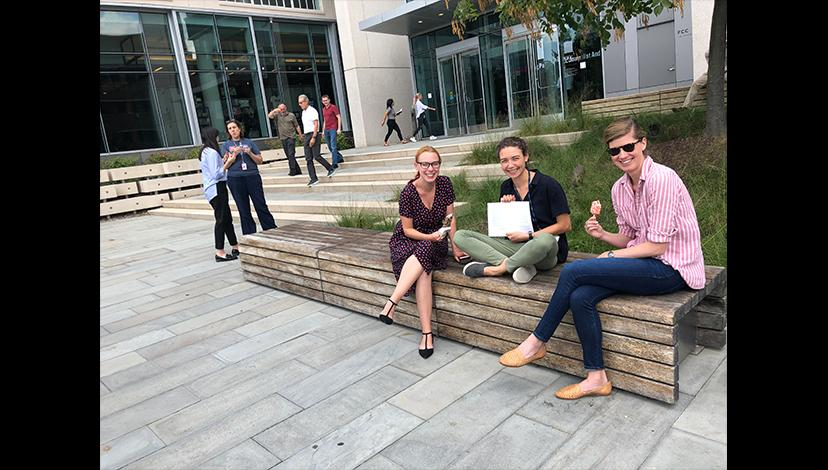 NPR staff members engage in ice cream and conversation outside of the station's D.C. headquarters.