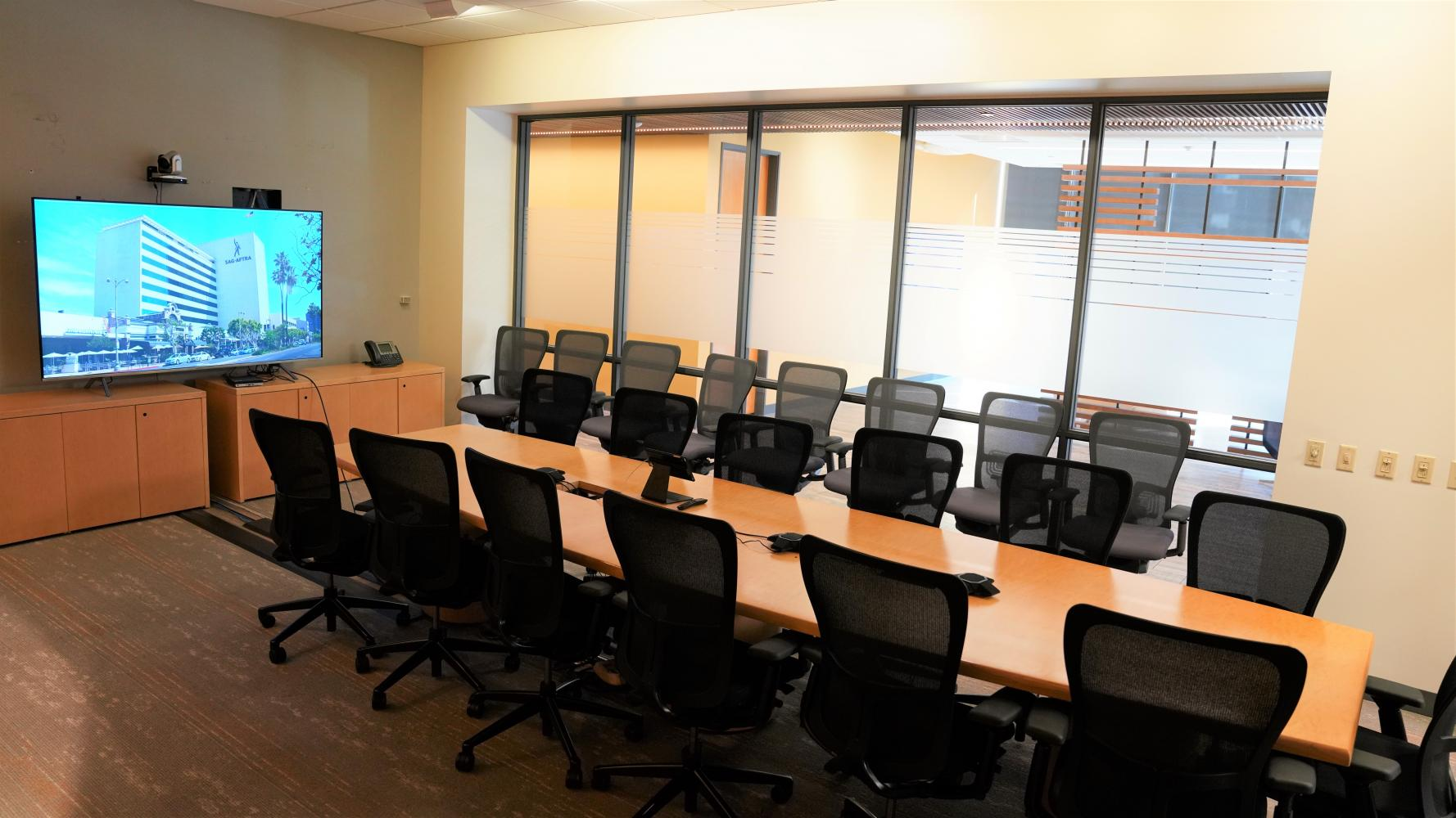 Conference Room with a large table in the middle and chairs all around.