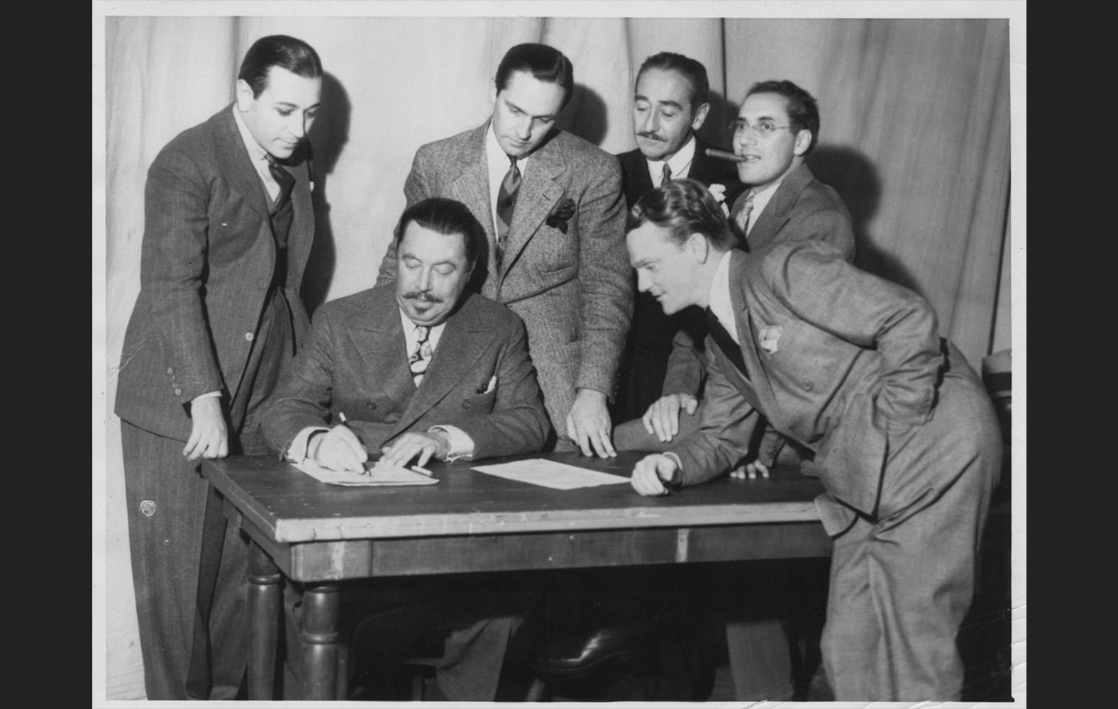Stars join SAG in October. George Raft, Warner Oland, Fredric March, Adolphe Menjou, Groucho Marx, James Cagney.