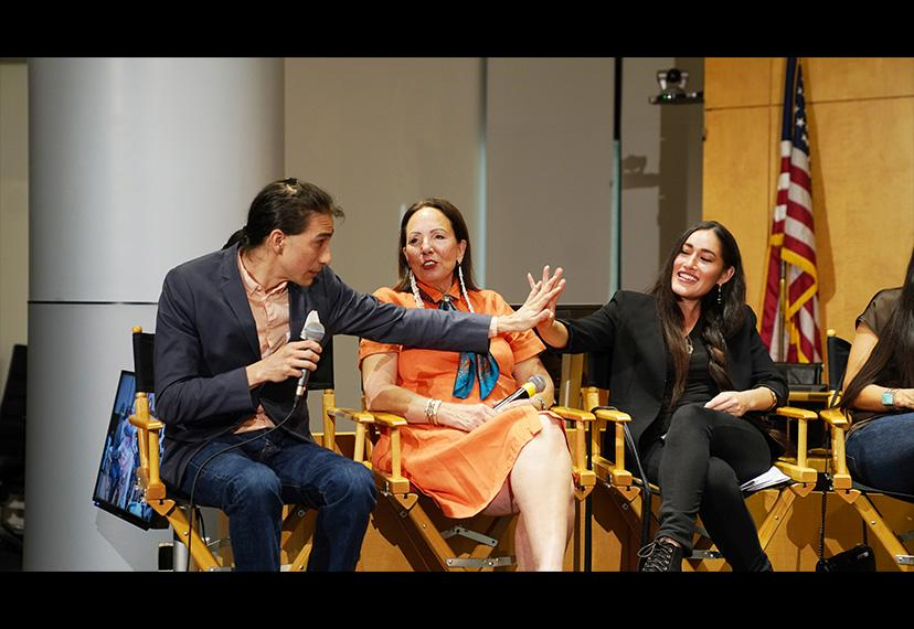 Tokala Black Elk, far left, and Q'orianka Kilcher give each other a high-five on the panel.