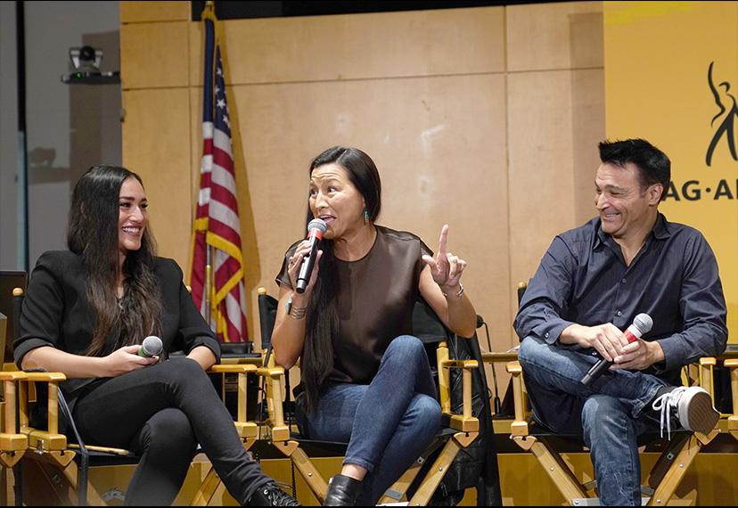 An anecdote from SAG-AFTRA member Kimberly Guerrero, center, draws laughter from fellow performer Q'orianka Kilcher, left, and WGA writer Jason Gavin.