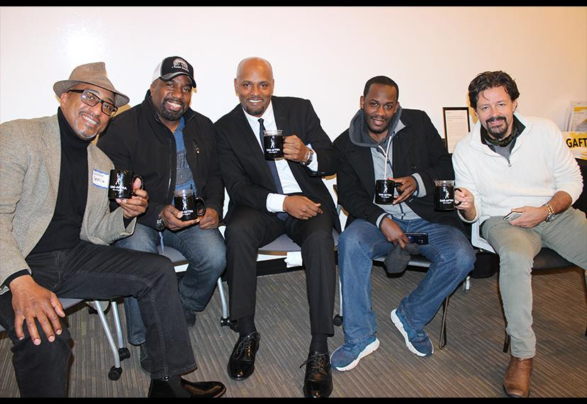 "From left, members Naheem Garcia, David Soloman Clarke, Mugisha Feruzi, Harkeem Springer and Marshall Bereson say ""cheers"" with their new SAG-AFTRA New England mugs."