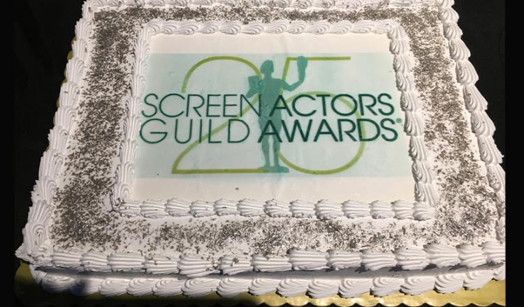 A large cake with white icing bearing the 25th Annual SAG Awards logo.