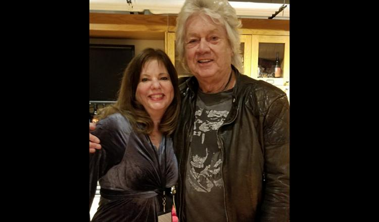 Joan Hammel and John Lodge talk shop.