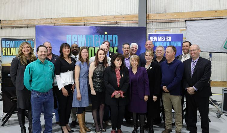 New Mexico Gov. Michelle Lujan Grisham, fourth from right, front row, is joined by industry stakeholders at the signing of SB 2 into law.