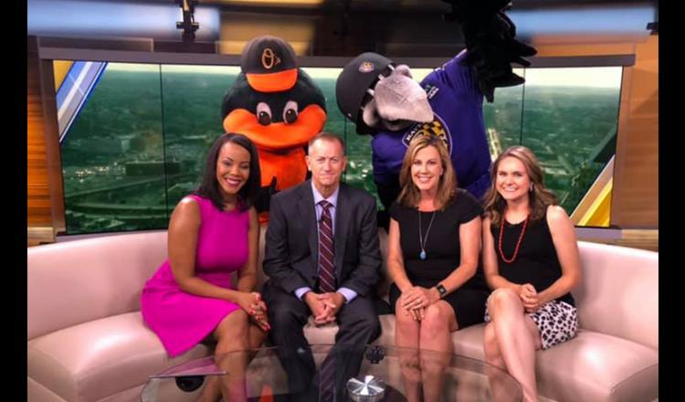 From left, WBAL's Theo Hayes, Keith Mills, Jennifer Franciotti and Lacee Griffith with the Orioles and Ravens team mascots.