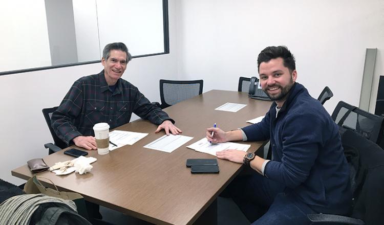Jim Damis, left, and Kalvin Haltenhof plan a busy day of set visits.
