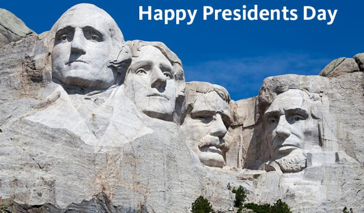 """Photo of Mount Rushmore with """"Happy Presidents Day"""" in top right corner in white text."""