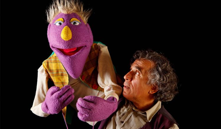 Puppeteers with purple puppet