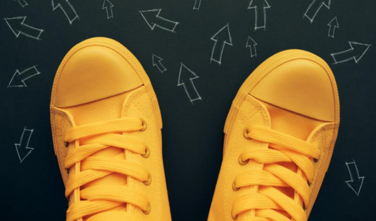 Image of yellow sneakers and arrows
