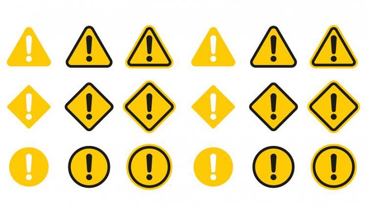 Señales de precaución amarillas y negras sobre un fondo blanco.