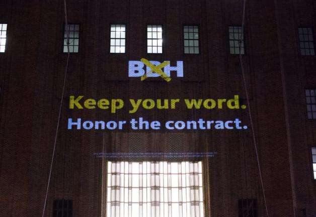 "Projection on a building ""BBH, Keep your word. Honor the contract."""