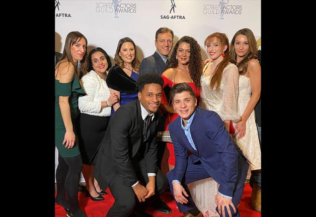 New England Local members have fun on the red carpet. Back row, from left: Ashley Cerrone, Alin Halajian, Michelle Romano, Robert Marsella, Anastasia Mousis, Kayla Caulfield and Kate Becker; front row, from left: Juvan Elisma and Domenic Arduino.