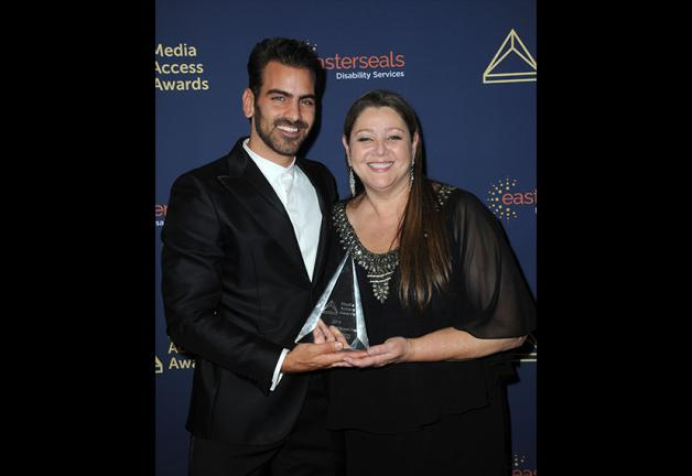 SAG-AFTRA Secretary-Treasurer Camryn Manheim, right, and actor and deaf community advocate Nyle DiMarco on Nov. 14. DiMarco received the Harold Russell Award at this year's ceremony.