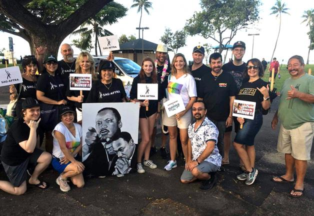 Hawaii 5-0's Dennis Chun, Magnum P.I.'s Amy Hill and Stephen Hill throw some shakas before the march.