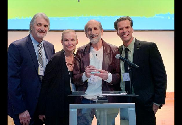 McLauglin-Zimet Union Spirit Award recipient Steve Gladstone, center, flanked by award presenters Dave Corey, National Board member Nancy Duerr, and Miami Local President John McKarthy.