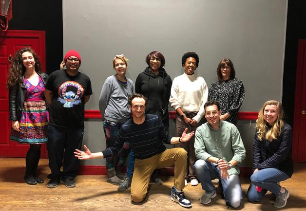 National Board member Phoebe Jonas, back row, far right, and Josh Evans, front row, left, with Peoples Improv Theater performers.