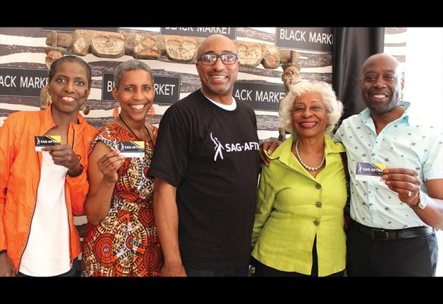 From left, members Gilda James, New England Local President Andrea Lyman, Naheem Garcia, Carmen Dillion and Wayne Miller at RoxFilm.