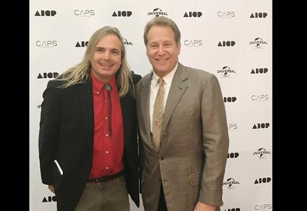 Twin Cities Local President Peter Moore, right, and AICP Minnesota Vice President Ace Allgood pose on the red carpet at the 2019 AICP Awards show in Minneapolis. (Photo by Ace Allgood.)