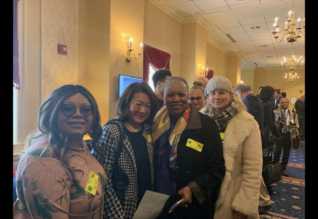 From left, Washington–Mid Atlantic Local members Towanda Underdue, Ellie Wang, Maggie Linton and Dovile Mark show their support for SB718.
