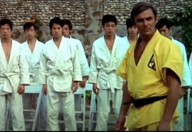 Saxton in yellow gi with others in the background in white gi
