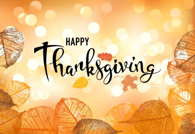 """Happy Thanksgiving"" on a gold light orb background with orange yellow and brown leaves along the sides and bottom of the graphic"