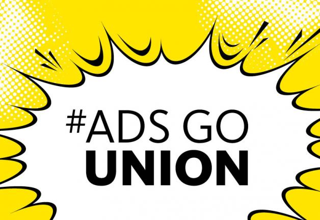 #AdsGoUnion in black text in a white speaking bubble on a yellow background