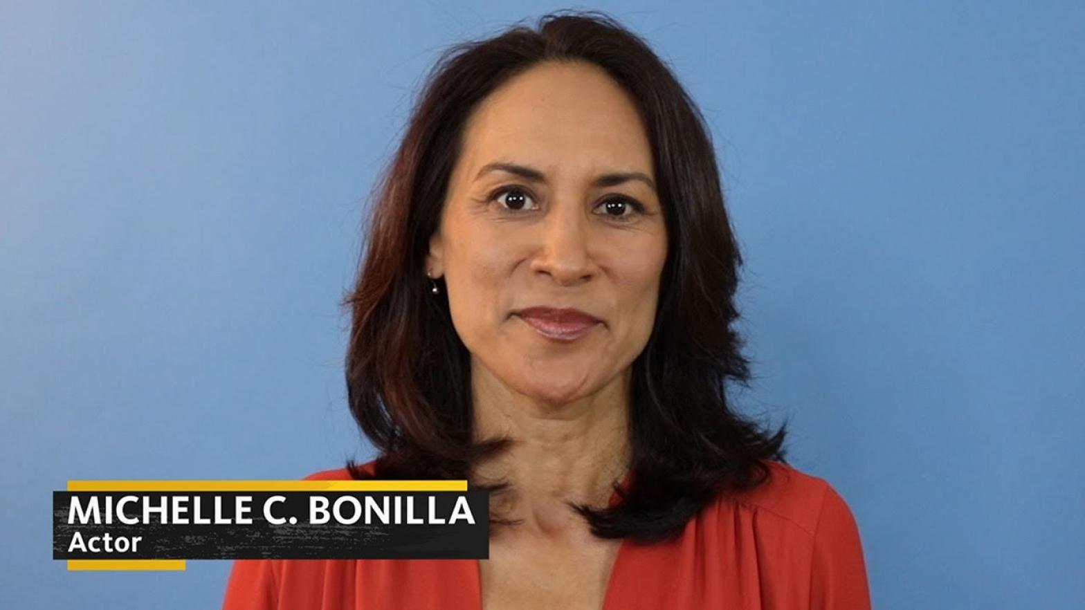 Bonilla in pink top on a blue background